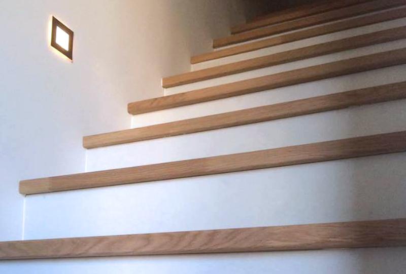 traptreden afgewerkt met hout